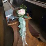 Grünwerkstatt Rose an der Kirchenbank